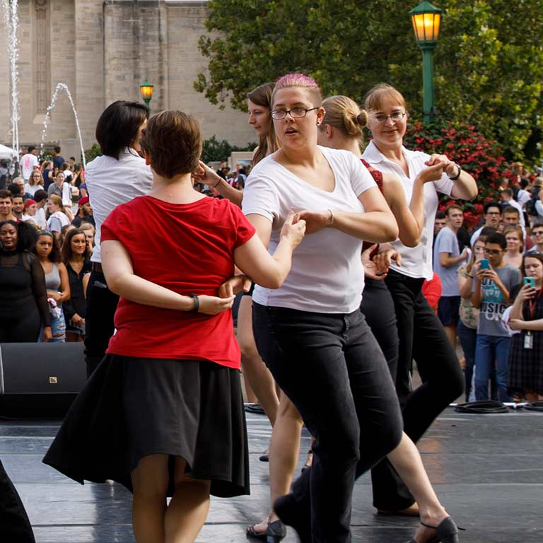 Students dance in front of Showalter Fountain on the Indiana University Bloomington campus.