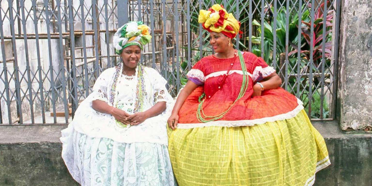 Two women in African costumes.
